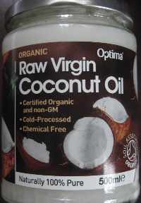 "Label on a jar showing ""Optima raw virgin coconut oil"" and pieces of broken coconut"