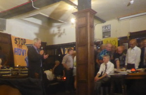 "20 September 2018: Gordon Peters speaking at a celebration in Tottenham. ""STOP THE HDV!"" reads the banner behind him."