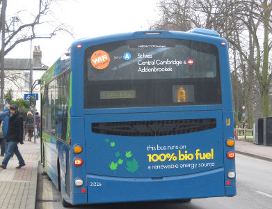 'this bus runs on 100% bio fuel a renewable energy source' on the back of a bus in Cambridge