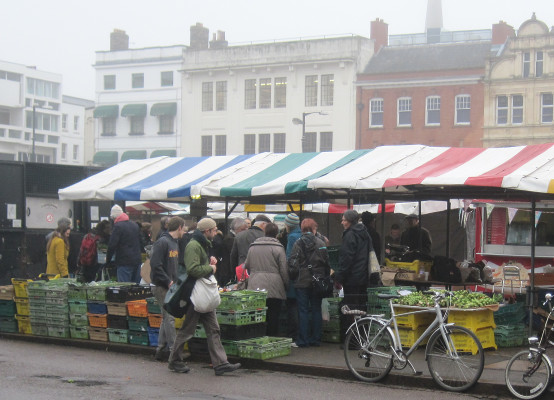 A queue at a local farm vegetable market stall in Cambridge