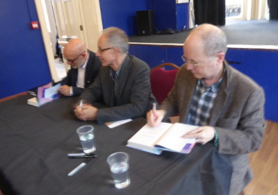 26 Nov 2017: James Thornton, Martin Goodman & Brian Eno signing copies of 'Client Earth' in Cambridge